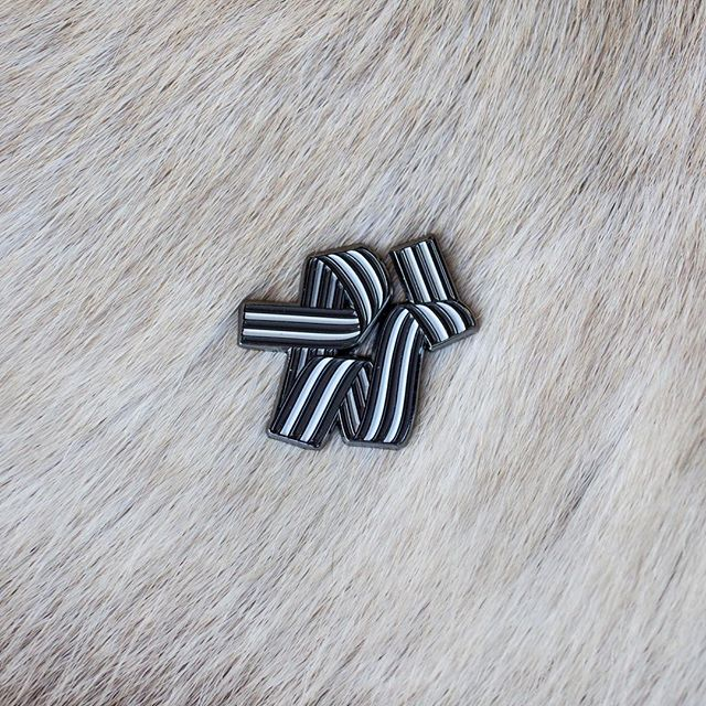 Ribbon No. 3 enamel pin. This one's a micro version of that steel and maple wall hanging.