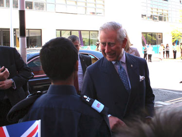 Prince Charles speaking to Mohammed Abdus Samad, Police Cadet