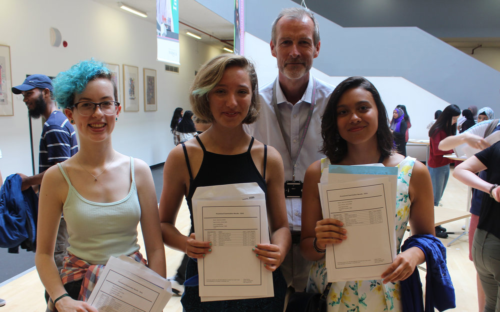 Myrtle Bolt (nine A*-A), Beattie Green (nine A*) and Sherinne Ghoneim (seven A*-A) pose with Executive Headteacher Grahame Price whilst celebrating their outstanding GCSE results.