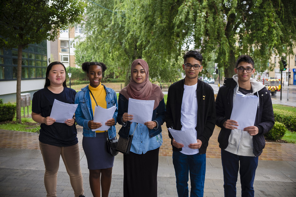 GCSE Students securing top results from left to right:   Jenny Hunyh, Alanna Alberto-Assis, Tahera Miah, Labib Khan and Bilal Ahmed