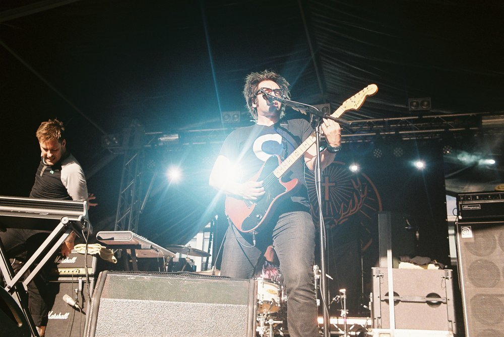 Towards the end of May 2014 I took on the challenge of shooting at my very first live event (Slam Dunk) entirely manual and on 35mm film.  This is a shot from Motion City Soundtrack's afternoon set.  I used a Pentax K1000, 35mm prime lens and Ektar ISO 100 colour film in order to achieve this shot.  I love dramatic lighting and light flairs, they just look so impressive on film.  The entire day was a drastic experimentation and a means to gain vital experience in using film at live events.  I can't say it was easy but I really enjoyed the day and feel that I've learnt an awful lot.  My aim now is to shoot at more festivals and work a lot closer with bands.