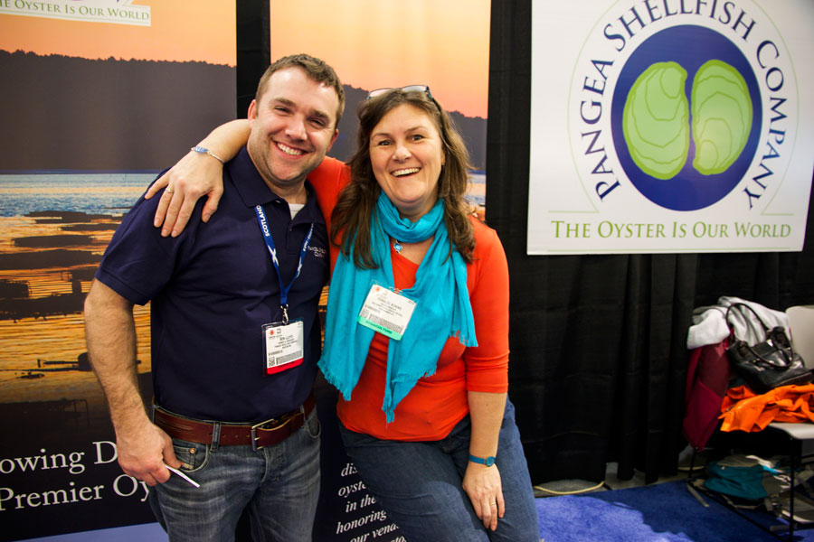 Fiona de Koning of Acadia Aqua Farms visits the Pangea Shellfish Company booth at the 2014 Seafood Expo North America.