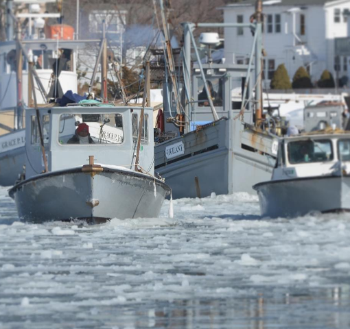 norm bloom's fleet breaking through an iced over harbor