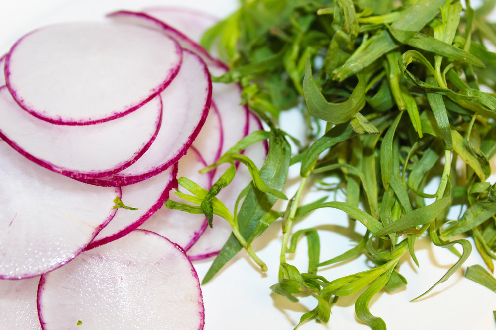 radishes offer a peppery punch to the sweet tarragon in this dish