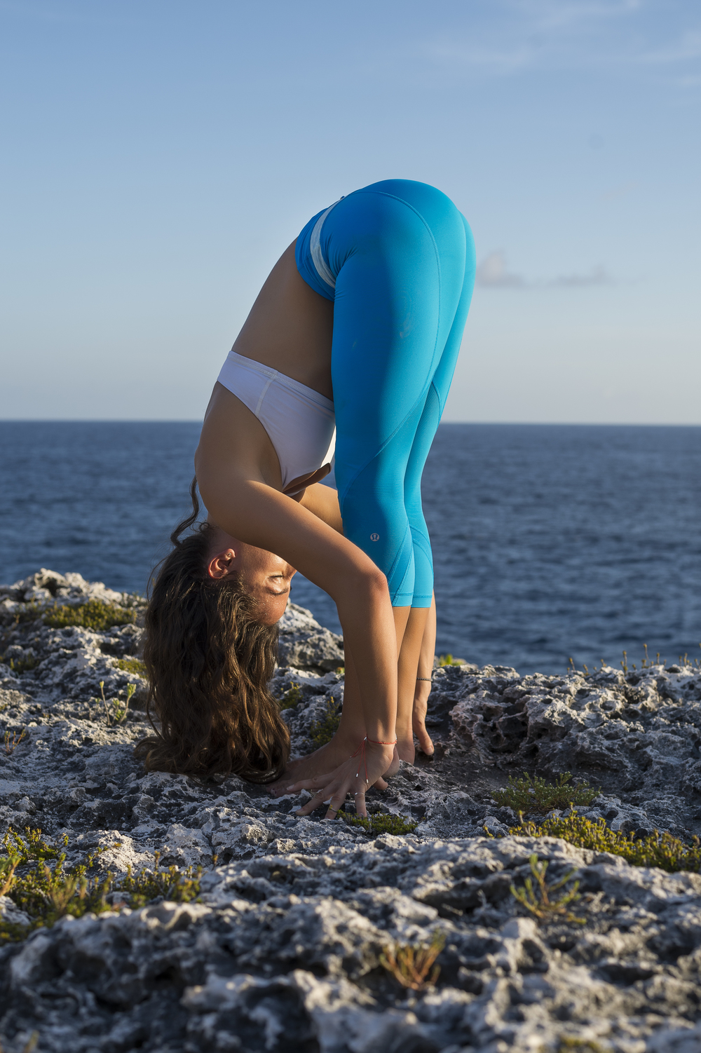 Forward fold on clifftop #Yoga