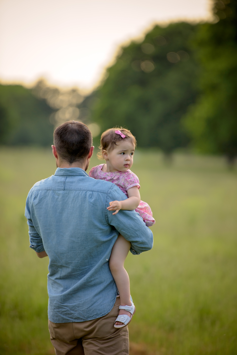 Father and daughter portrait in meadows