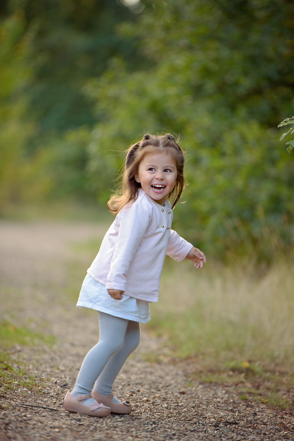 Portrait of a child laughing in Autumn colours