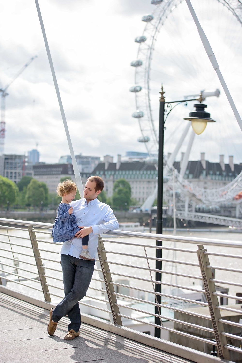Family photos with London Eye in background