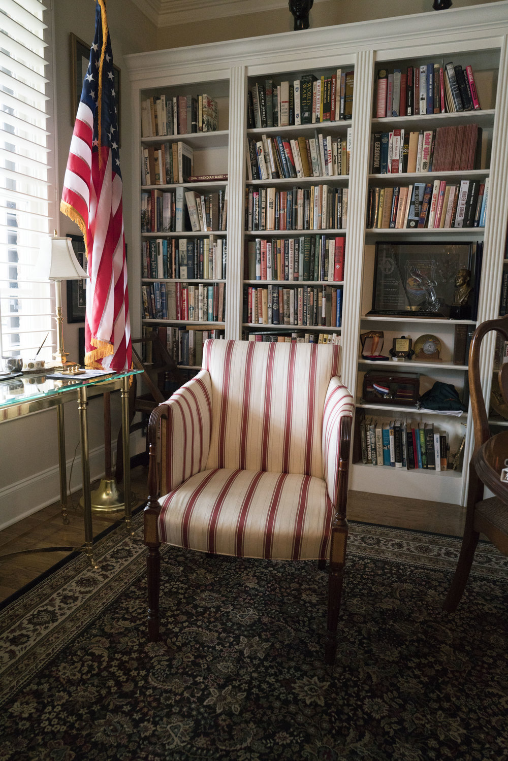 We feel like this chair is the best candidate. It's stately, solid, comfortable and tight enough to allow for minimal movement.The General's daughter thinks this is a good option and also said that, regardless of which chair we use, he will need a pillow.