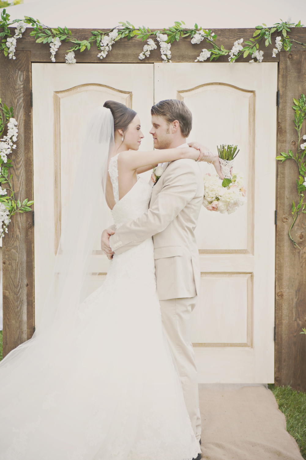 This bride had rustic doors for her outdoor ceremony entrance. They were just beautiful!