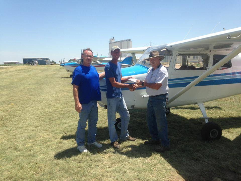 Marshall Watson presenting Brock Stapelton with the title to the airplane he won from Kingdom transport! Jim Russom, Vice President of Kingdom Transport, was also at presentation.