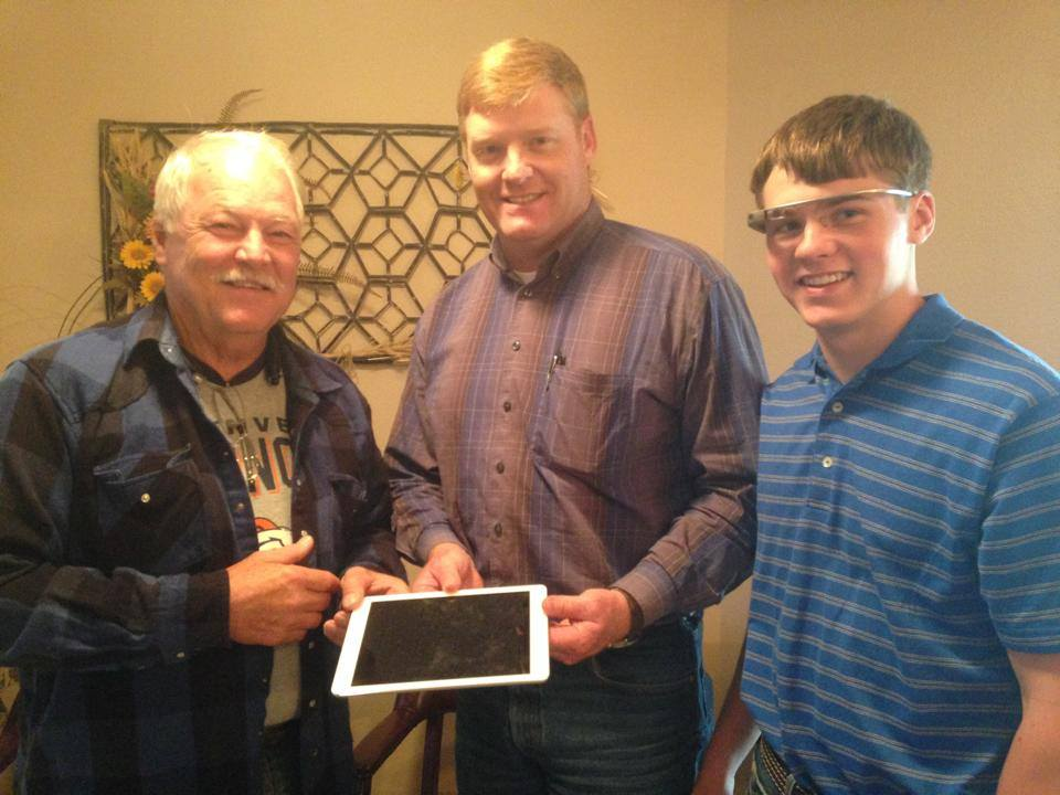 This is the picture of the presentation of the 2nd place raffle winner. Marshall Watson is giving an iPad to Jay Garetson and his son.
