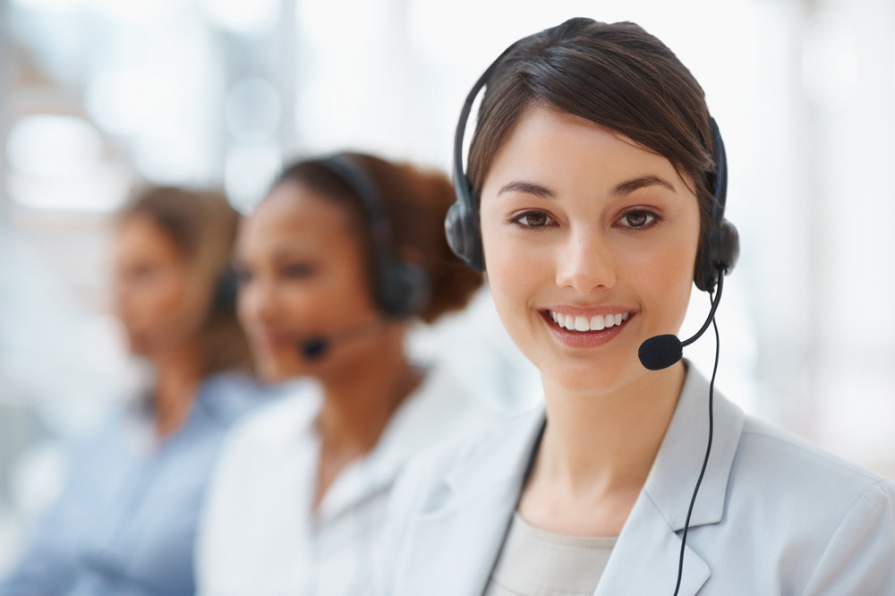 Closeup of a call center employee with headset at work