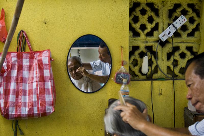 Peluquero callejero, Kuala Lumpur