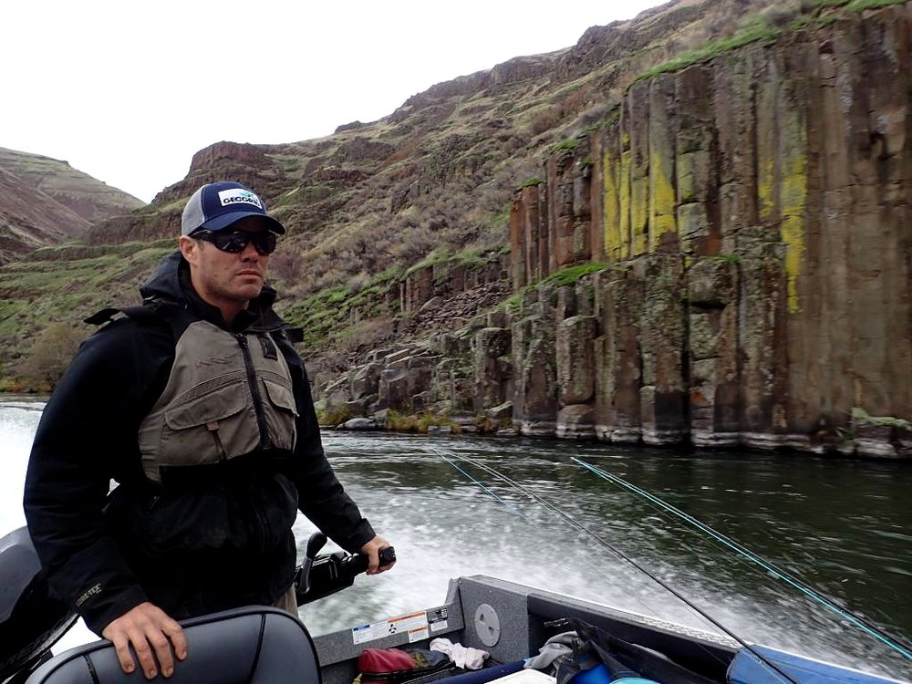 Guide driving jet boat passed Nookie Rock on the Lower Deschutes.jpg