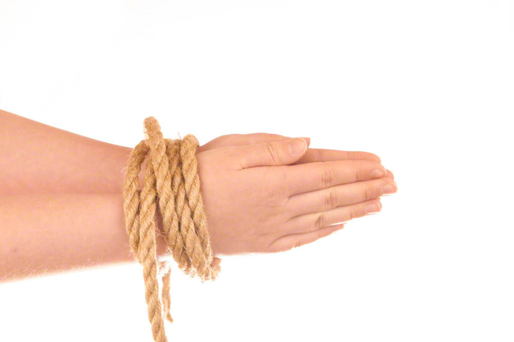 Hands tied with natural hemp
