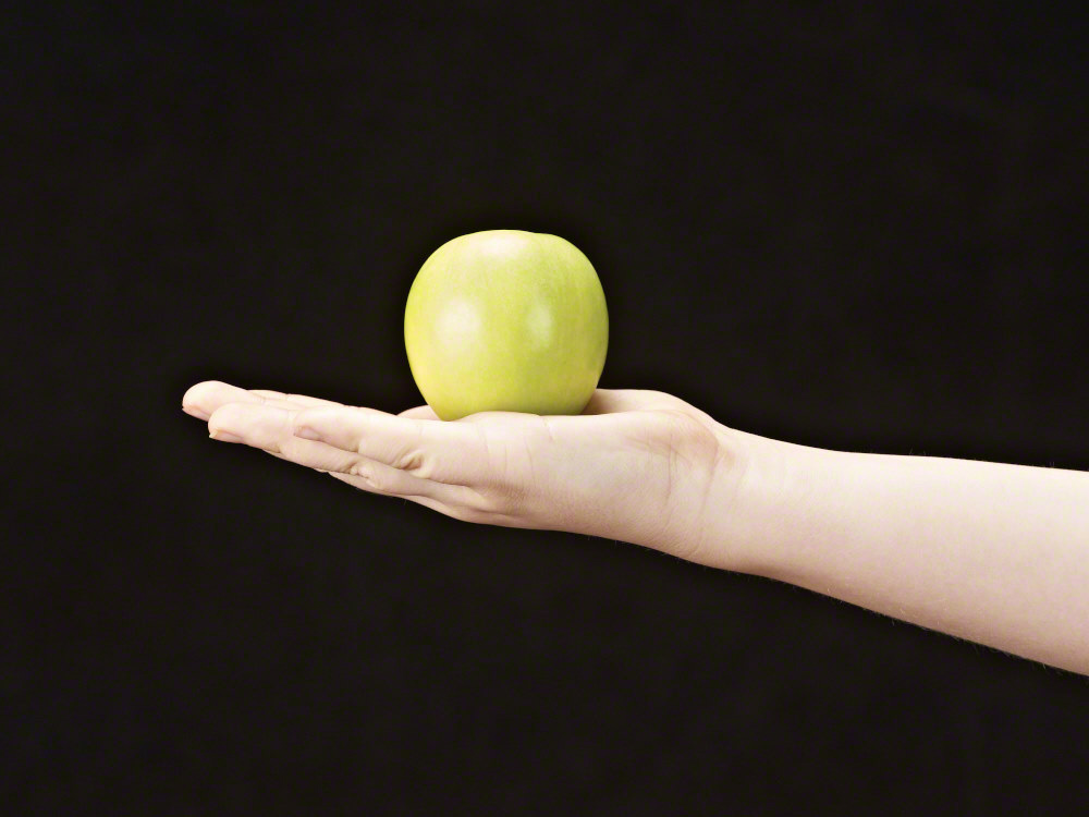 Apple in the palm of girls hand