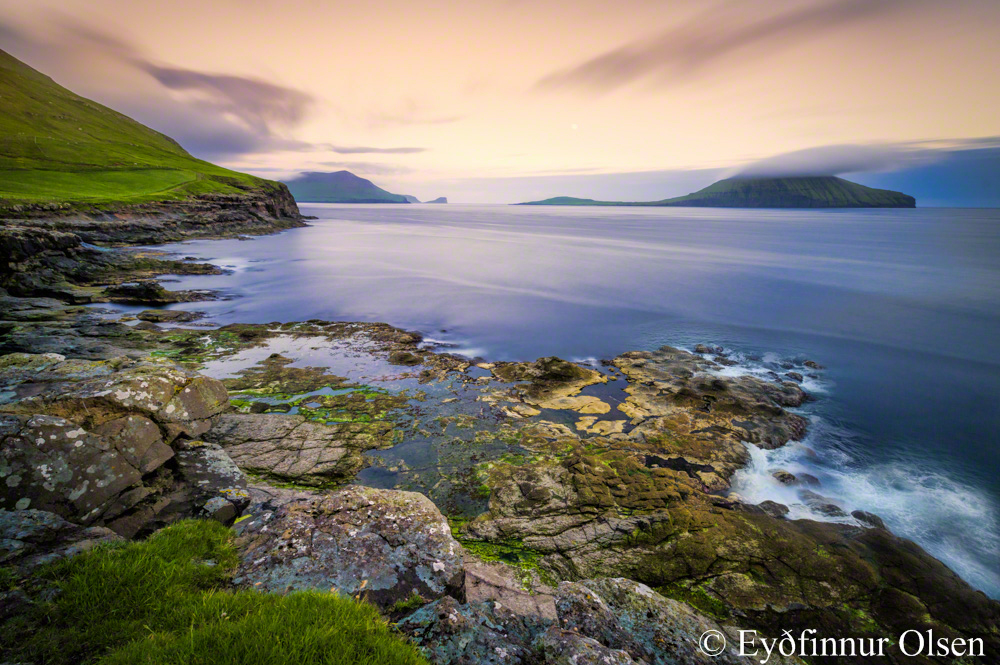View from Sydradalur towards the island Koltur in the Faroe Islands at about sunset