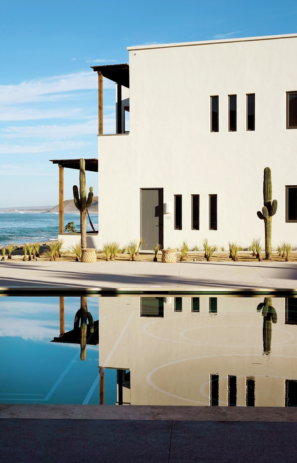 THE LIFE AQUATIC | The pool area of Hotel San Cristóbal, which overlooks Playa Punta Lobos. Photo: Pia Riverola for WSJ. Magazine