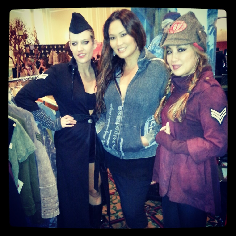 Tia Carerra modeling the House Hoodie with International Citizen Designers Sheena Gao and Laura Krusemark at the 2014 Oscar Suites.
