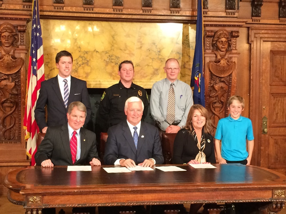 Standing from left to right is Jon Hopcraft. Lt. Matthew Johnson, David Johnson, Adyson Johnson Sitting from left to right is Senator David Argall, Governor Tom Corbett, Representative Tina Davis .