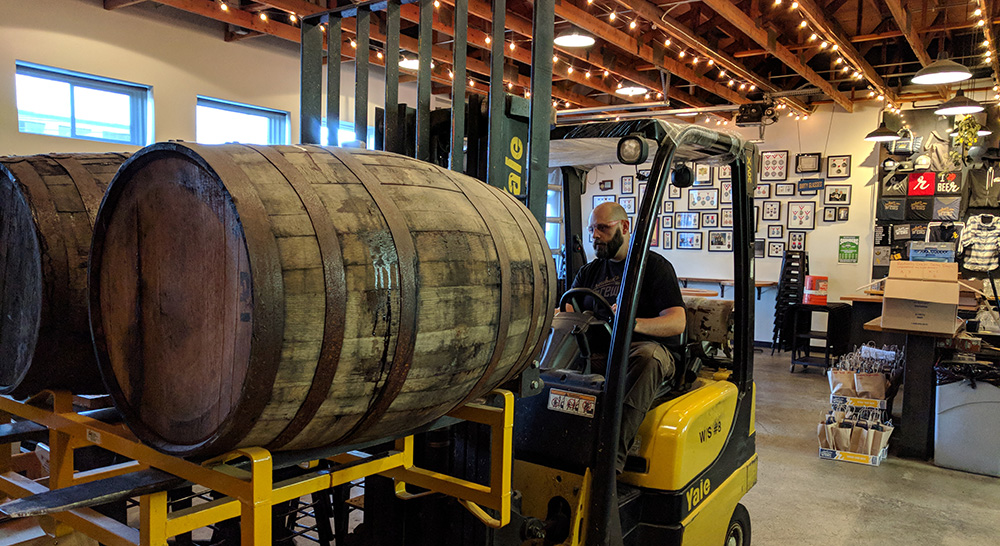 Thor taking barrels from the tasting room to the final blending