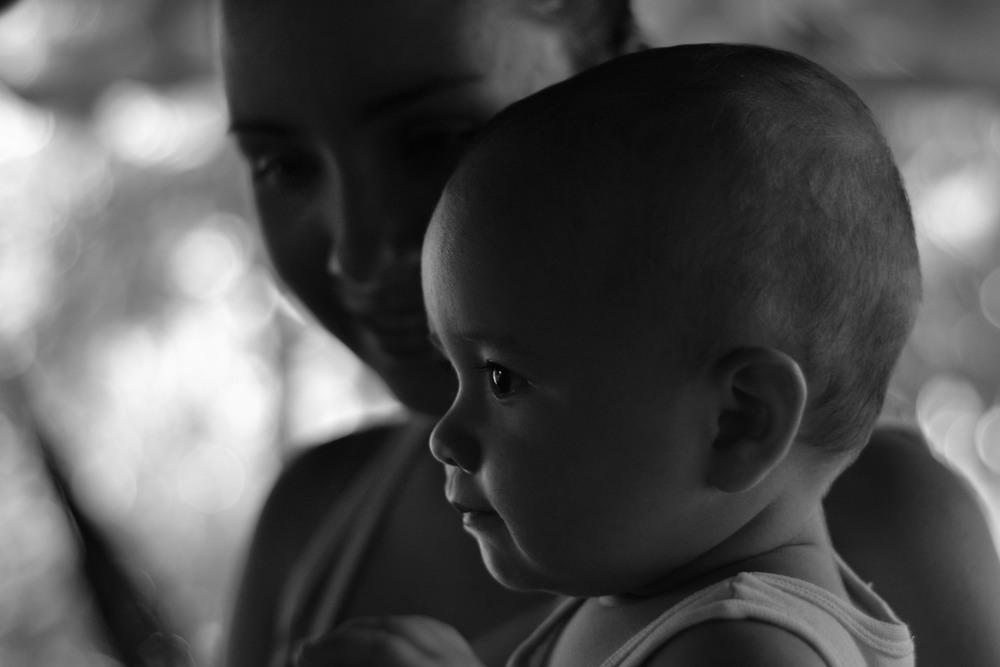 The grandchild of La Iguana, gazing intently at a visitor
