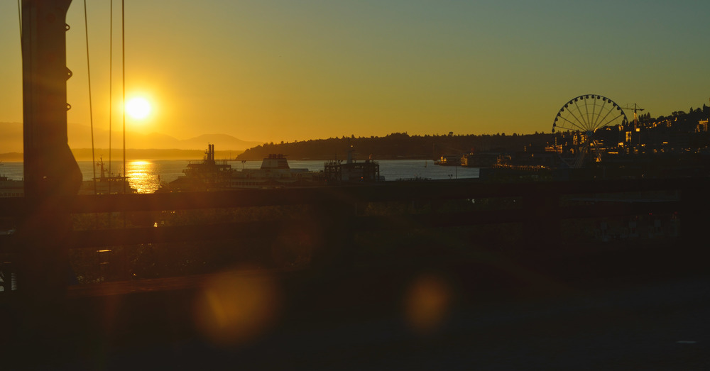 Sunset over the waterfront as seen from the highway going into Seattle