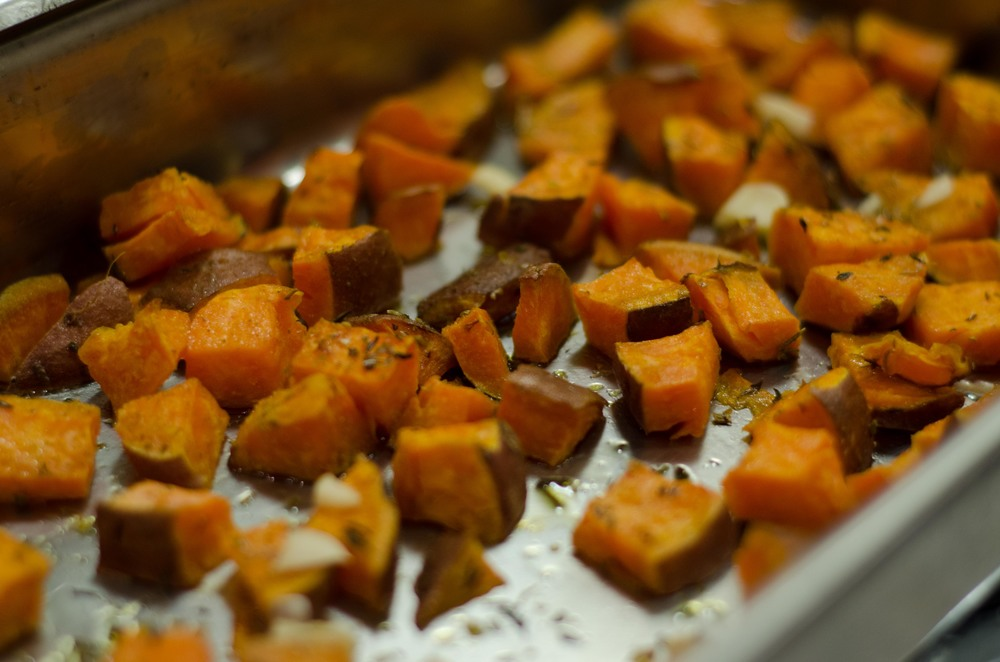 Human feeding time: roasted sweet potatoes with herbs, thanks to Alex.  Nom nom.