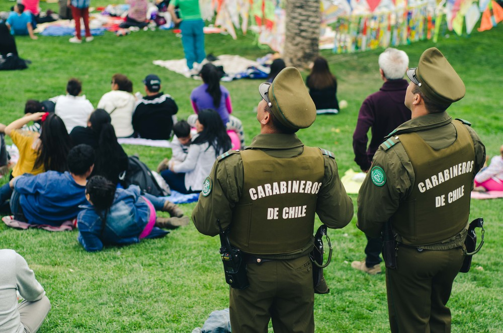 Carabineros (Chilean police) watching the parachuter demonstration