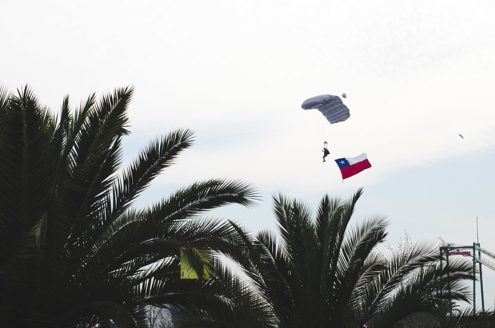 One of several parachuters coming down the parade runway.