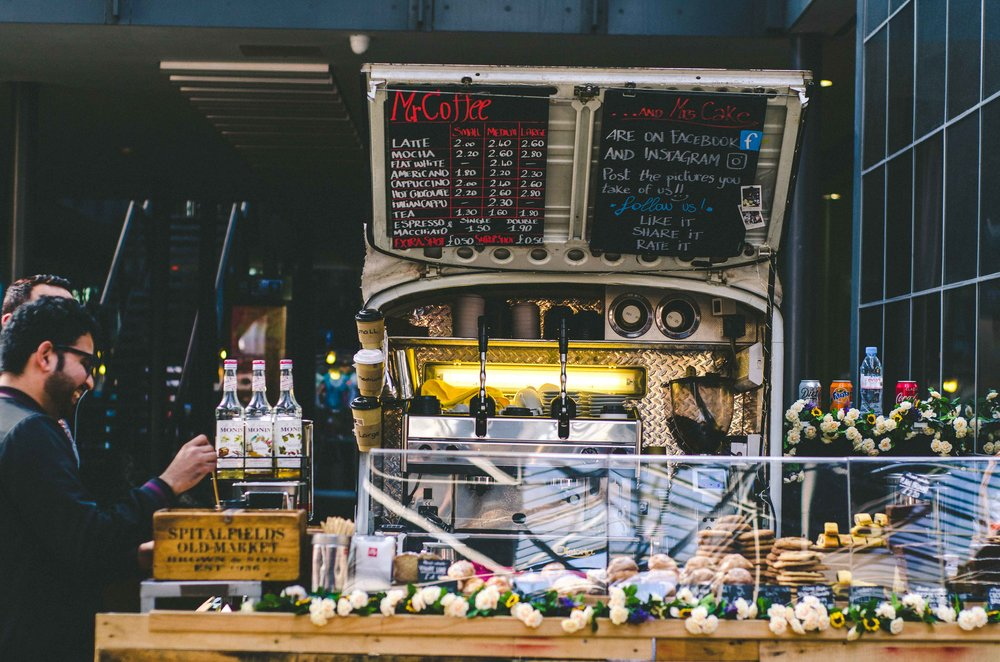 Cute coffee truck at an indoor market.