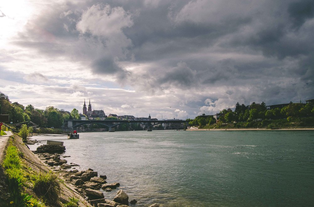 Sitting on the banks of the Rhine, watching the sky roil