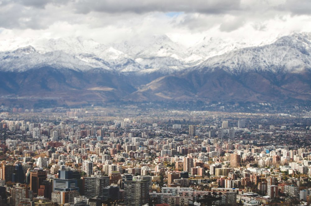 Santiago is in a  cuenca , a basin whose sides are the Andes mountains on one side and the coastal mountains on the other. It makes for beautiful views, but it traps the smog.