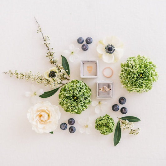 Use flowers, leaves, and berries to create an intricate flatlay that includes your ring. Styling by  Bella Lu Floral  and The Styled Soiree, photo by  Decorus Fine Art Photography