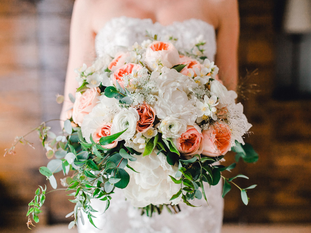 Bride's bouquet with garden roses, peonies, and hydrangeas for a summer wedding