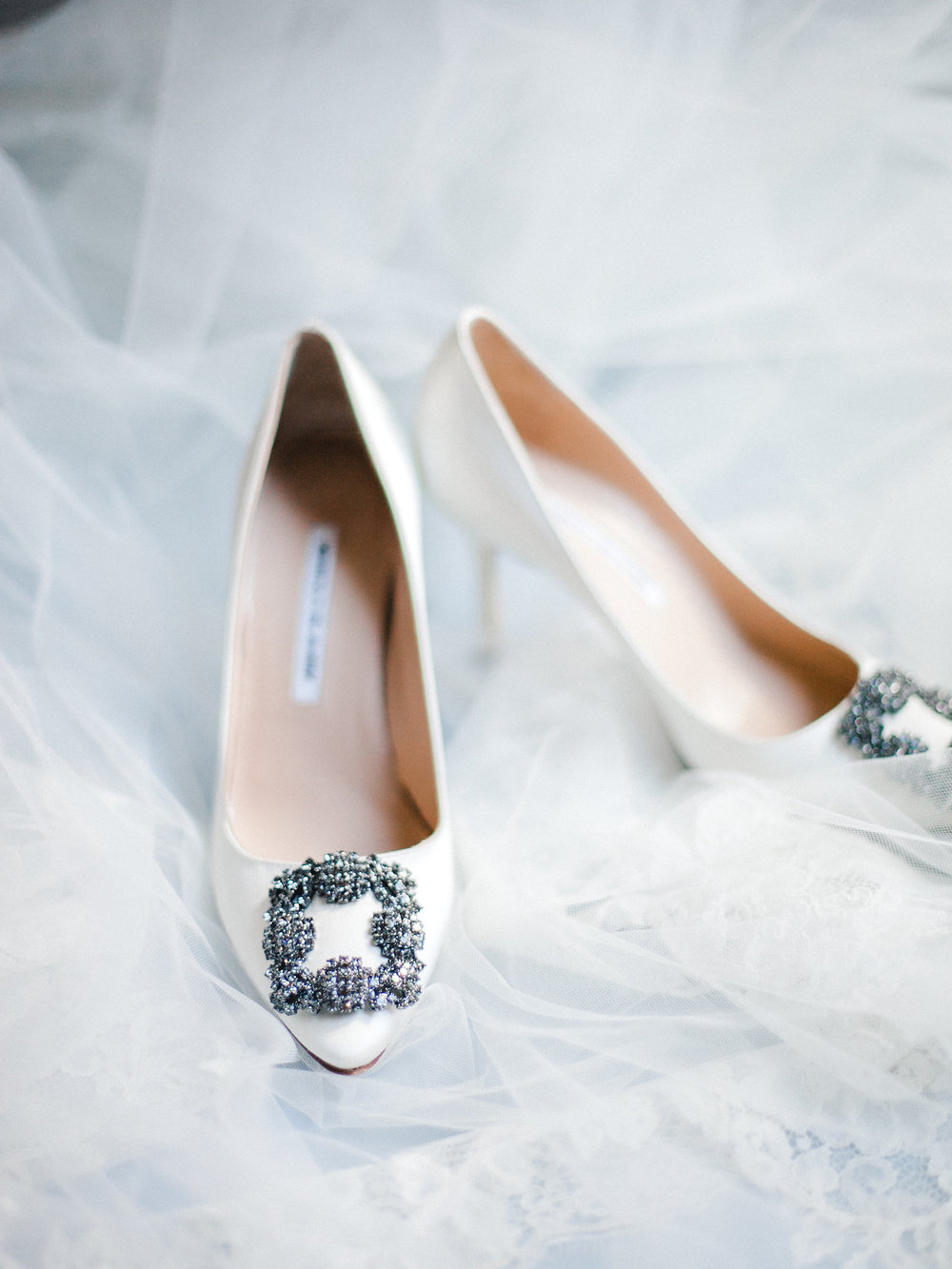 Manolo Blahnik Hangisi wedding shoes in white with a veil