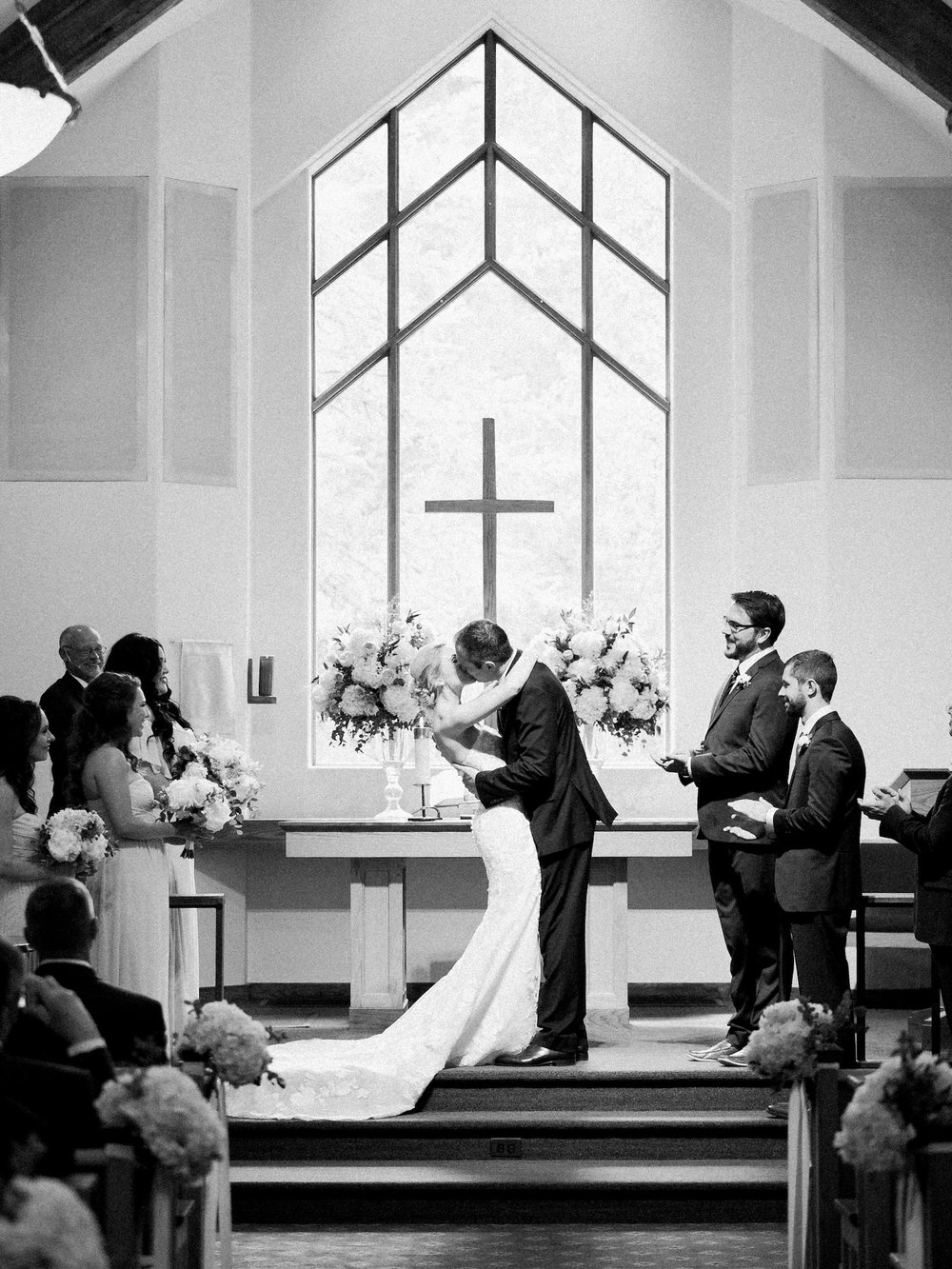 First Kiss at Vail Interfaith Chapel during a wedding ceremony