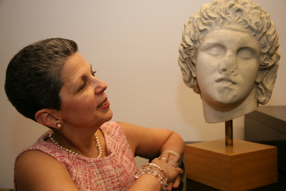 Georgette Gouveia  with a bust of Alexander the Great. Photograph by Bob Rozycki/courtesy WAG magazine.