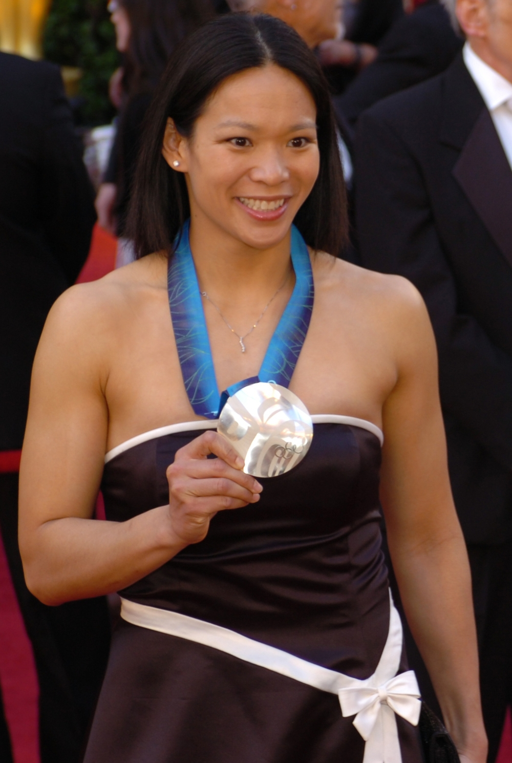 Julie Chu with her 2010 U.S. women's hockey silver medal at the 82nd Academy Awards. Photograph by Sgt. Michael Connors