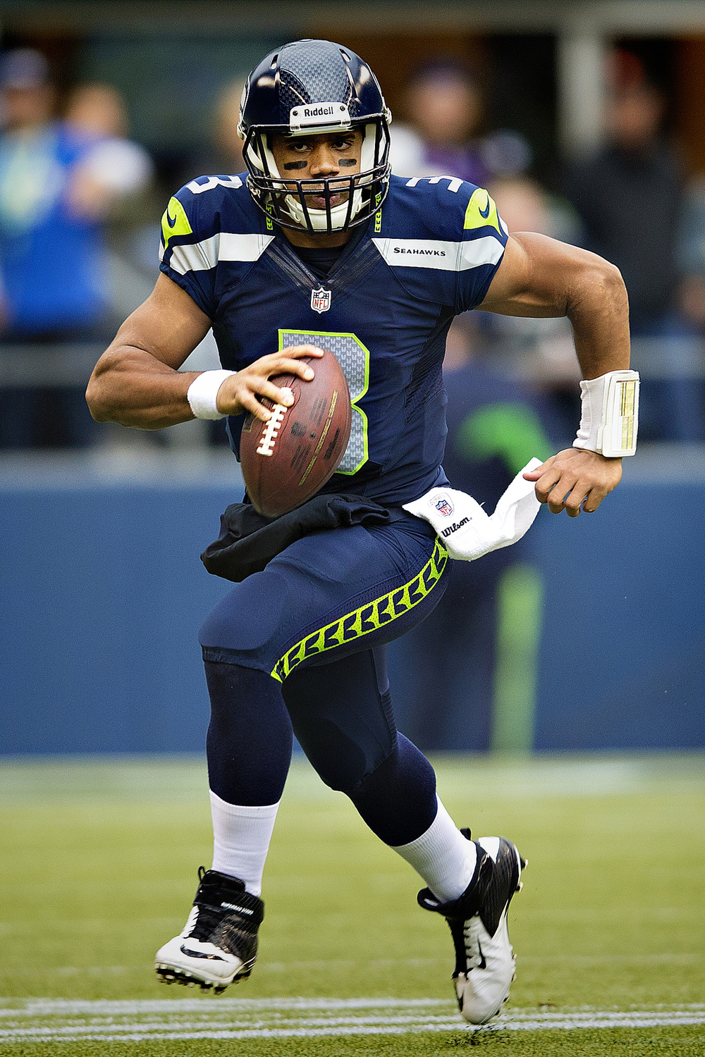 Russell Wilson, quarterback of the Seattle Seahawks, in action against the Minnesota Vikings in 2012. The Seahawks have great taste in colors, no? Photograph by Larry Maurer.