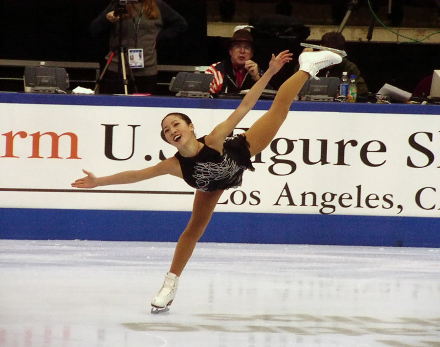 Practice makes perfect, or does it? Michelle Kwan in one of her signature spirals at the 2002 U.S. Figure Skating Championships. Photograph by Kevin Rushforth.