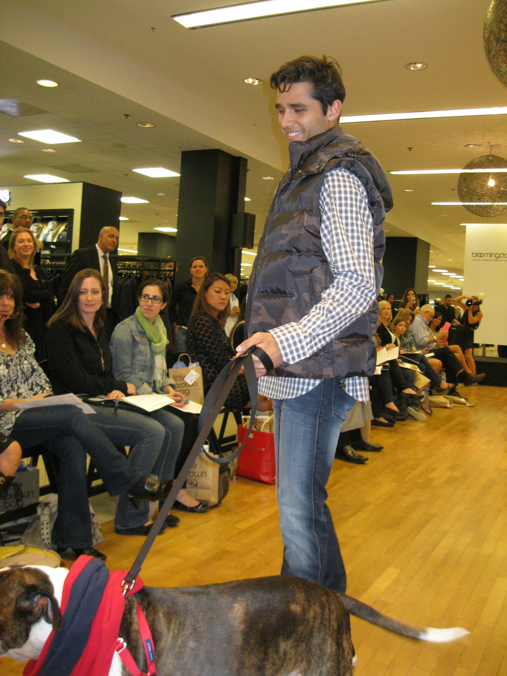 Model Bruno, with friend in Michael Kors' camouflage vest and plaid button down shirt and Hugo slim fit medium wash jeans