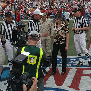 NFL referees at the coin toss for the 40  th   Pro Bowl. Will Sarah Thomas be joining them? Photograph by U.S. Navy Mate Don Bray.