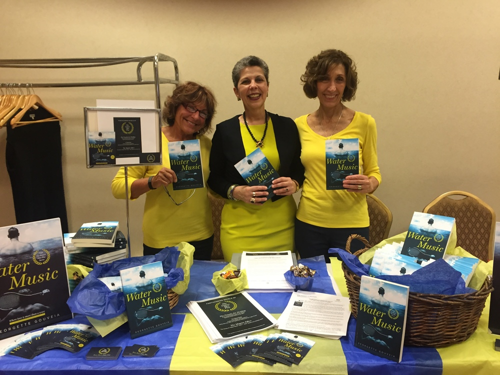 """With friends, helpers and """"bookends"""" Wendy Pandolfi (left) and Mary Azzuriti. """"We popped,"""" Mary said of the vibrant color scheme reflecting """"The Games Men Play"""" brand."""