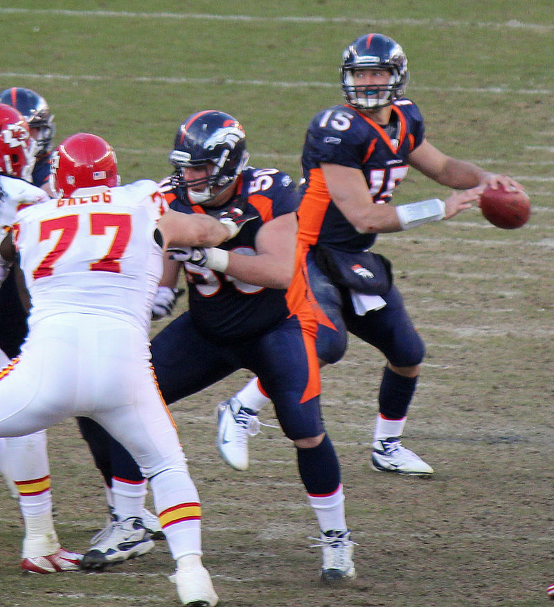 Tim Tebow in action with the Denver Broncos against the Kansas City Chiefs in January of 2012. Photograph by Jeffrey Beall.
