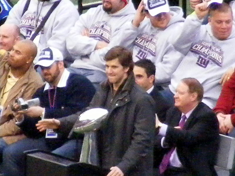Eli Manning with the Vince Lombardi Trophy at the New York Giants' Super Bowl XLII victory rally, Giants Stadium, 2008. It was one of two Giants' Super Bowl victories that came at Tom Brady and the New England Patriots' expense. Photograph by Ted Kerwin.