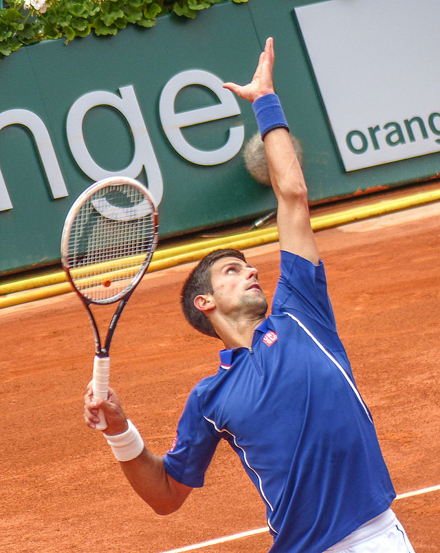 "Novak Djokovic at the French Open in 2013, the year he lost a brilliant five-set heartbreaker to Rafael Nadal in the semifinals. As the Open looms, can he, in the title of his book, ""Serve to Win""? Photograph by Yann Caradec."