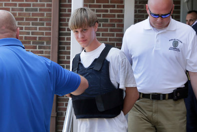 Dylann Storm Roof being escorted from the Shelby Police Department in Shelby, N.C., on Thursday. Photo credit to  The New York TImes .