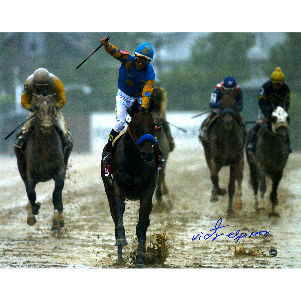 A signed photograph of Victor Espinoza aboard American Pharoah as they triumph in a muddy Preakness.